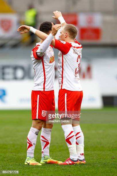 Erik Thommy and Alexander Nandzik of Regensburg celebration after the third league match between SC Paderborn and Jahn Regensburg at Benteler Arena...