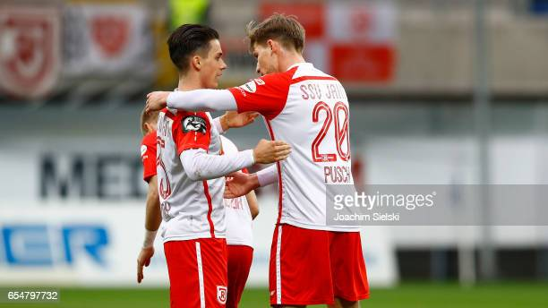 Erik Thommy and Kolja Pusch of Regensburg celebration after the third league match between SC Paderborn and Jahn Regensburg at Benteler Arena on...