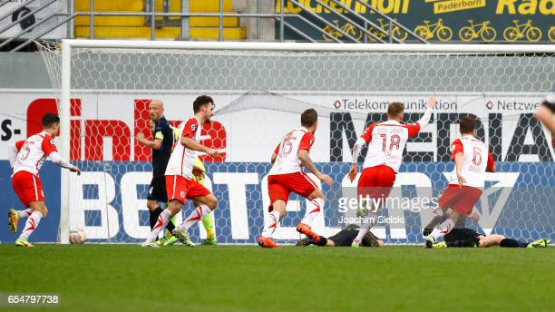 Erik Thommy Haris Hyseni Marco Gruettner Marc Lais and Benedikt Saller of Regensburg celebration the Goal 01 during the third league match between SC...