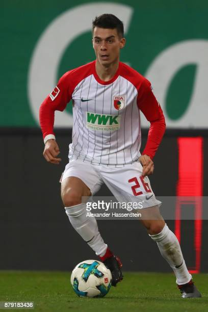 Erik Thommy of Augsburg runs with the ball during the Bundesliga match between FC Augsburg and VfL Wolfsburg at WWKArena on November 25 2017 in...