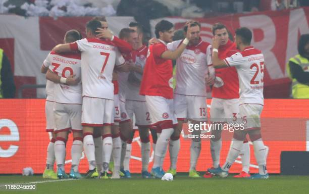 Erik Thommy of Duesseldorf celebrates with team mates after scoring his teams second goal during the Bundesliga match between Fortuna Duesseldorf and...