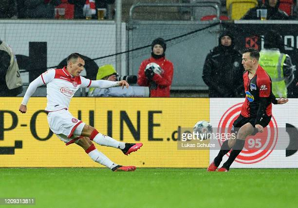 Erik Thommy of Duesseldorf scores his team's second goal during the Bundesliga match between Fortuna Duesseldorf and Hertha BSC at Merkur SpielArena...