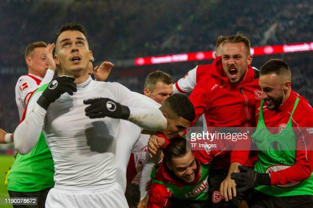 Erik Thommy of Fortuna Duesseldorf celebrates after scoring his team's second goal with team mates during the Bundesliga match between Fortuna...