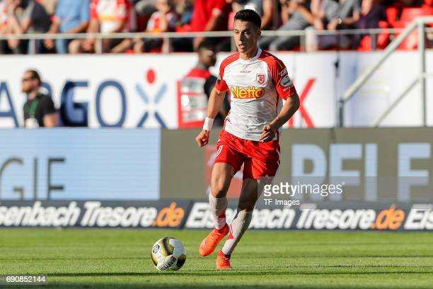 Erik Thommy of Jahn Regensburg controls the ball during the Second Bundesliga Playoff first leg match between Jahn Regensburg and TSV 1860 Muenchen...