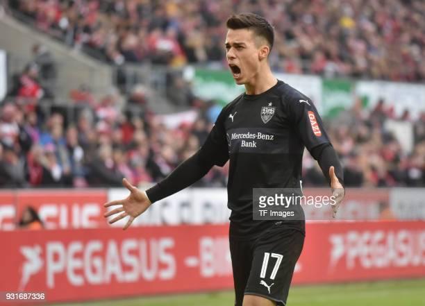Erik Thommy of Stuttgart celebrates after Andreas Beck of Stuttgart scored their team`s third goal during the Bundesliga match between 1 FC Koeln and...