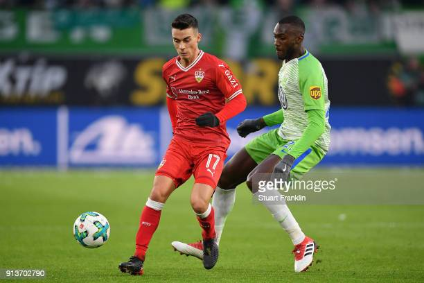 Erik Thommy of Stuttgart fights for the ball with Joshua Guilavogui of Wolfsburg during the Bundesliga match between VfL Wolfsburg and VfB Stuttgart...