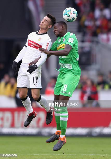 Erik Thommy of Stuttgart jumps for a header with Denis Zakaria of Moenchengladbach during the Bundesliga match between VfB Stuttgart and Borussia...