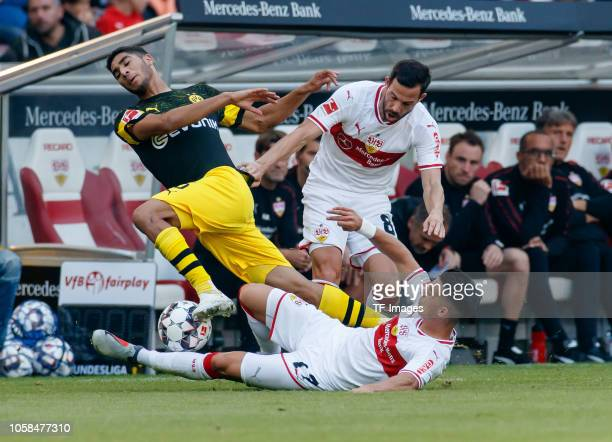 Erik Thommy of VfB Stuttgart Gonzalo Castro of VfB Stuttgart and Achraf Hakimi of Borussia Dortmund battle for the ball during the Bundesliga match...