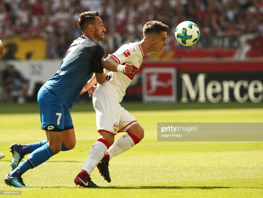 Erik Thommy of VfB Stuttgart is challenged by Lukas Rupp of 1899 Hoffenheim during the Bundesliga match between VfB Stuttgart and TSG 1899 Hoffenheim at Mercedes-Benz Arena on May 5, 2018 in Stuttgart, Germany.