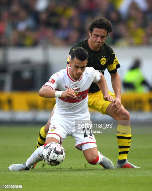 Erik Thommy of VfB Stuttgart is challenged by Thomas Delaney of Borussia Dortmund during the Bundesliga match between VfB Stuttgart and Borussia...