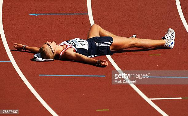 Erik Tysse of Norway crosses the line exhausted after finishing the Men's 20K Walk final on day two of the 11th IAAF World Athletics Championships on...