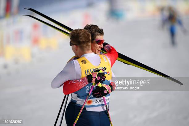 Erik Valnes and Johannes Hoesflot Klaebo of Norway celebrate following their victory in the Men's Cross Country Team Sprint Finals at the FIS Nordic...