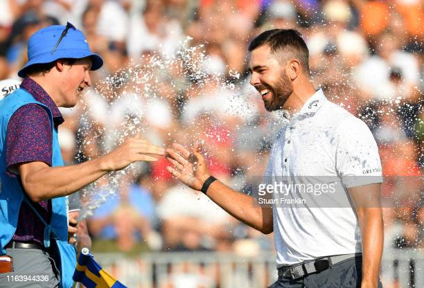 Erik Van Rooyen of South Africa celebrates with caddie Alex Gaugert after his victory on the 18th green during the final round of the Scandinavian...