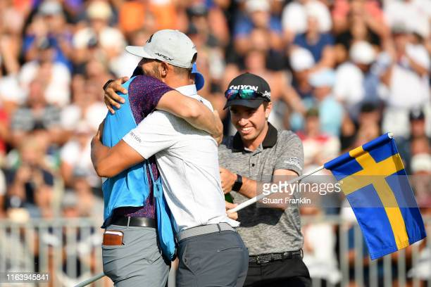 Erik Van Rooyen of South Africa hugs caddie Alex Gaugert after his victory on the 18th green during the final round of the Scandinavian Invitation at...