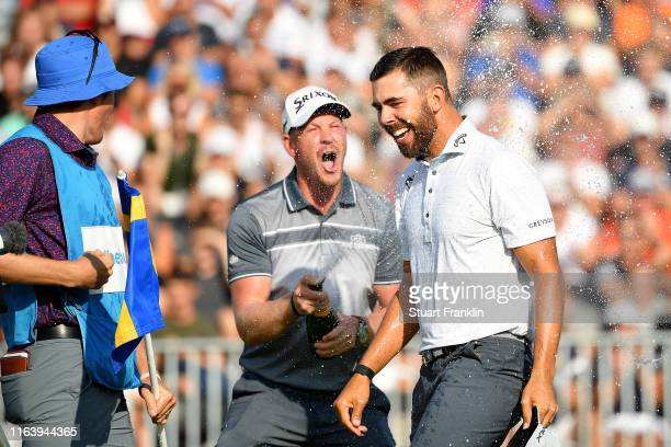 Erik Van Rooyen of South Africa is sprayed with champagne by Jacques Kruyswijk after his victory on the 18th green during the final round of the...