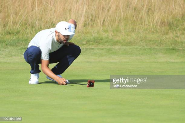 Erik Van Rooyen of South Africa lines up a par putt on the 12th green during the first round of the 147th Open Championship at Carnoustie Golf Club...