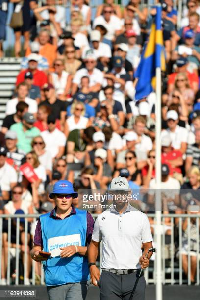 Erik Van Rooyen of South Africa looks on with caddie Alex Gaugert on the 18th green during the final round of the Scandinavian Invitation at Hills...