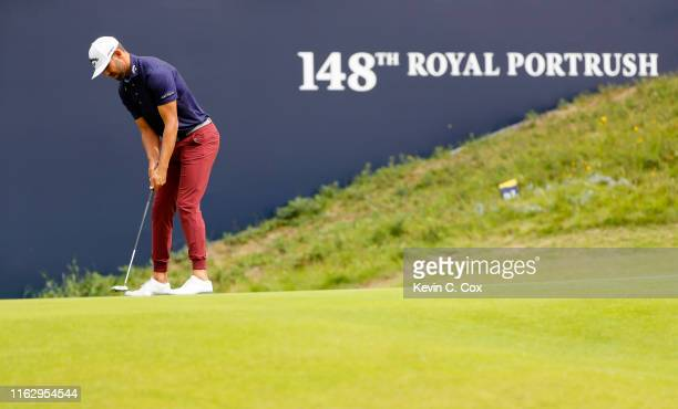 Erik Van Rooyen of South Africa plays a putt on the 18th green during the second round of the 148th Open Championship held on the Dunluce Links at...