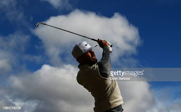 Erik van Rooyen of South Africa plays a shot on the 1st hole during day one of the 2018 World Cup of Golf at The Metropolitan on November 22, 2018 in...