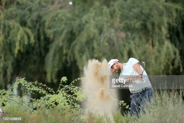 Erik Van Rooyen of South Africa plays his second shot on the 14th hole during the first round of the Omega Dubai Desert Classic on the Majlis Course...