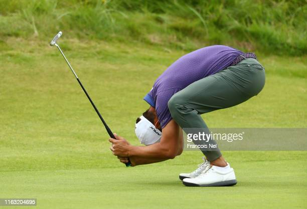 Erik Van Rooyen of South Africa reacts to his putt on the 18th green during the third round of the 148th Open Championship held on the Dunluce Links...