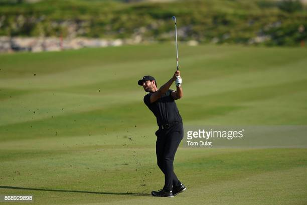 Erik Van Rooyen of South Africa takes a shot form the 18th fairway on Day One of the NBO Golf Classic Grand Final European Challenge Tour at Al Mouj...
