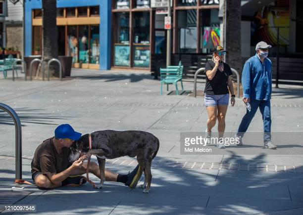 Erik Viking of Hermosa Beach gives his 12 year old dog Coco a Catahoula a kiss while visiting the Pier Ave Plaza in Hermosa Beach The nearby strand...