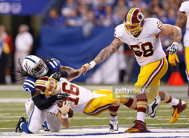 Erik Walden of the Indianapolis Colts sacks Colt McCoy of the Washington Redskins during the first half of the game at Lucas Oil Stadium on November...