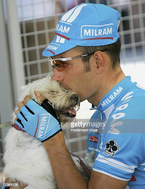 Erik Zabel of Germany and the Milram Team relaxes with his dog before Stage 3 of the 93rd Tour de France between Esch-sur-Alzette and Valkenburg on...