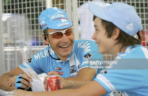 Erik Zabel of Germany and the Milram Team relaxes with his son before Stage 3 of the 93rd Tour de France between Esch-sur-Alzette and Valkenburg on...