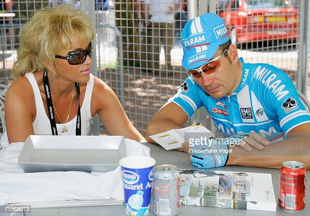 Erik Zabel of Germany and the Milram Team relaxes with his wife before Stage 3 of the 93rd Tour de France between Esch-sur-Alzette and Valkenburg on...