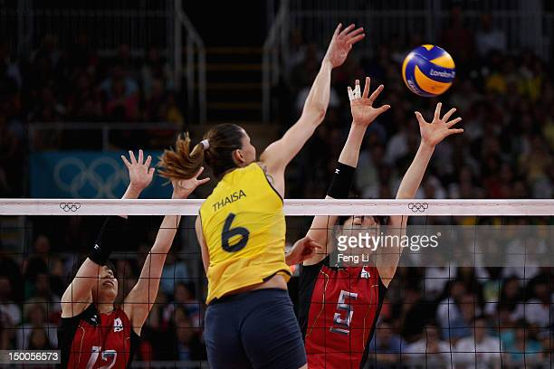 Erika Araki and Risa Shinnabe of Japan defend the ball from Thaisa Menezes of Brazil during the Women's Volleyball semifinal match on Day 13 of the...