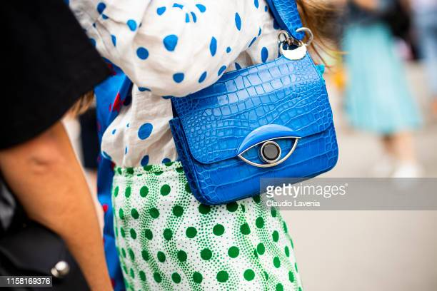 Erika Boldrin, blue Kenzo bag details, is seen outside Kenzo fashion show on Day 6 during the Paris Fashion Week Spring/Summer 202> on June 23, 2019...