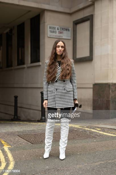 Erika Boldrin is seen on the street during London Fashion Week February 2019 wearing black/white checker coat with kneehigh white shoes on February...