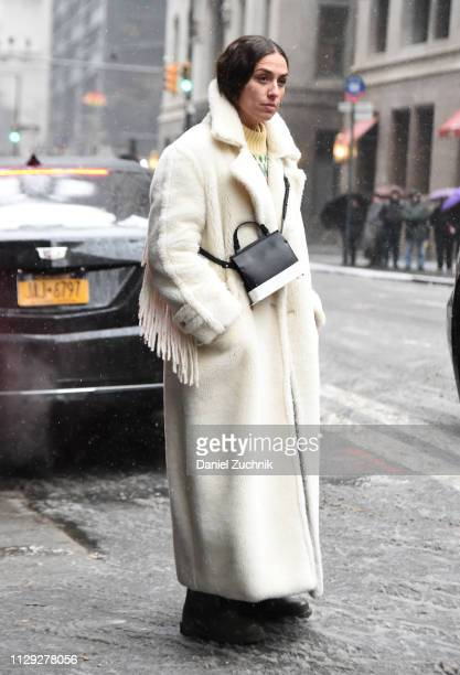 Erika Boldrin is seen wearing a white fur coat outside the Coach 1941 show during New York Fashion Week: Fall/Winter 2019 on February 12, 2019 in New...