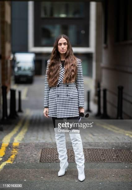 Erika Boldrin is seen wearing black white blazer white boots black tights outside Ports 1961 during London Fashion Week February 2019 on February 16...