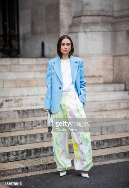 Erika Boldrin is seen wearing blue blazer green wide leg pants outside Stella McCartney during Paris Fashion Week Womenswear Fall/Winter 2019/2020 on...
