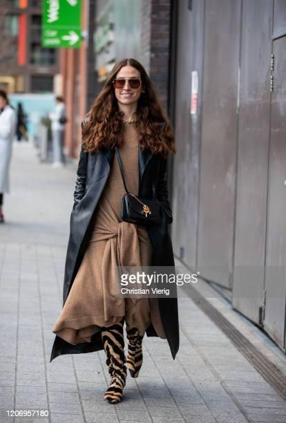 Erika Boldrin is seen wearing brown dress black coath Khaite boots with animal print black bag outside Christopher Kane during London Fashion Week...