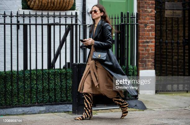 Erika Boldrin is seen wearing brown dress Khaite boots with animal print black leather jacket bag outside JW Anderson during London Fashion Week...