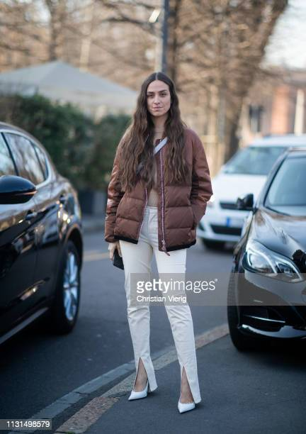 Erika Boldrin is seen wearing brown puffer jacket pants with slit white bag outside Tods on Day 3 Milan Fashion Week Autumn/Winter 2019/20 on...