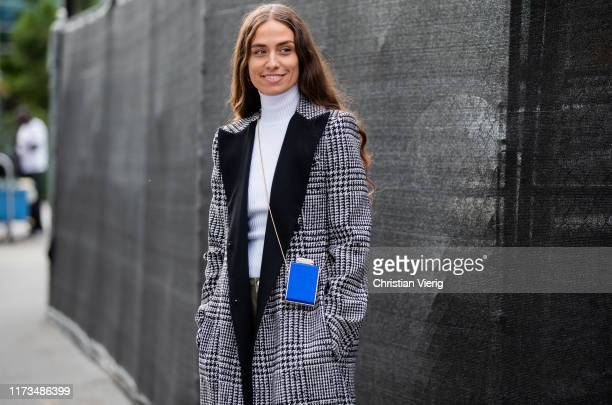 Erika Boldrin is seen wearing grey plaid coat blue mini bag outside Carolina Herrera during New York Fashion Week September 2019 on September 09 2019...