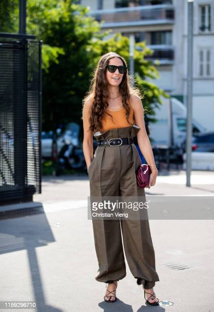 Erika Boldrin is seen wearing olive high waist pants bordeaux clutch yellow top outside Acne during Paris Fashion Week Haute Couture Fall/Winter...