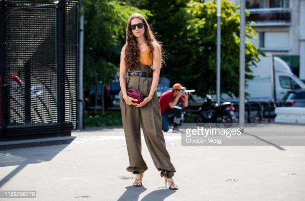 Erika Boldrin is seen wearing olive high waist pants, bordeaux clutch, yellow top outside Acne during Paris Fashion Week - Haute Couture Fall/Winter...