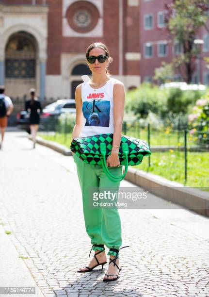 Erika Boldrin is seen wearing sleeveless shirt and green pants plaid clutch outside M1992 during the Milan Men's Fashion Week Spring/Summer 2020 on...