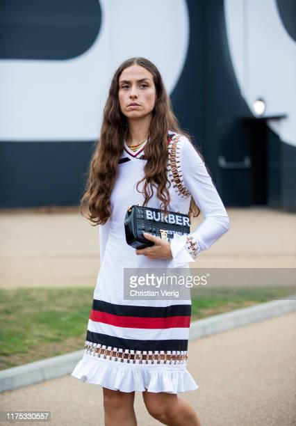 Erika Boldrin is seen wearing white dress with stripes, Burberry bag outside Burberry during London Fashion Week September 2019 on September 16, 2019...
