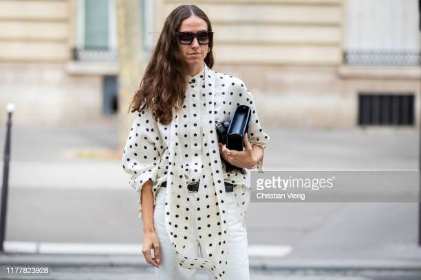 Erika Boldrin is seen wearing white pants blouse with dots print black bag outside Altuzarra during Paris Fashion Week Womenswear Spring Summer 2020...