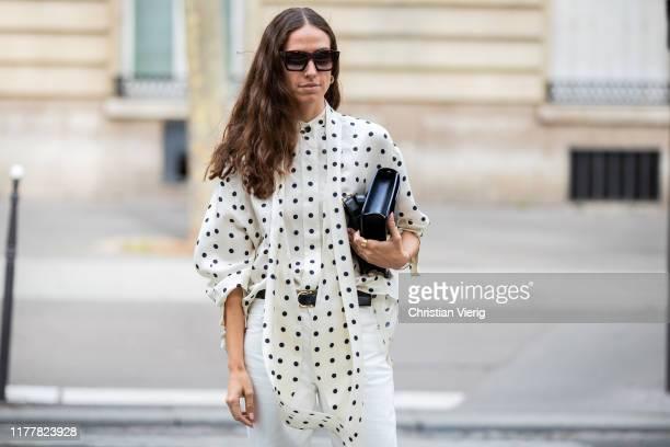 Erika Boldrin is seen wearing white pants, blouse with dots print, black bag outside Altuzarra during Paris Fashion Week Womenswear Spring Summer...