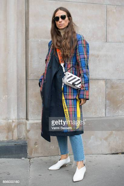 Erika Boldrin poses wearing a JW Anderson X Uniqlo trenchcoat and an Off White bag after the Acne Studios show at the Pavillion Cambon during Paris...
