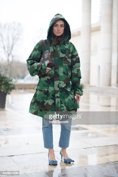 Erika Boldrin poses with a camo military jacket and Louis Vuitton bag after the Valentin Yudashkin show at the Palais de Tokyo during Paris Fashion...
