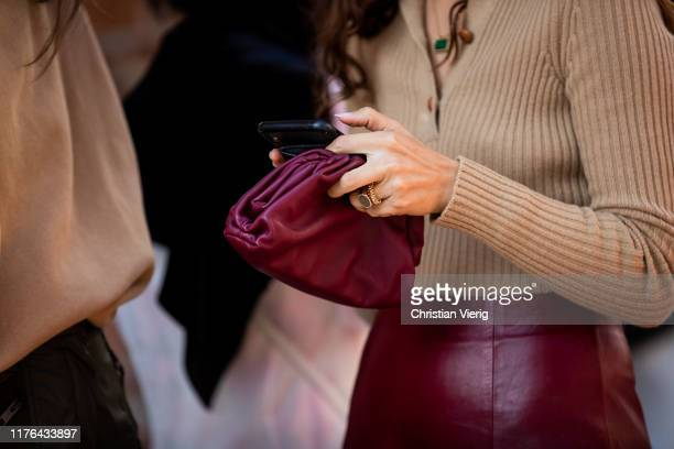Erika Boldrin seen wearing beige knit bordeaux Bottega Veneta mini pouch bag leather skirt outside the Ferragamo show during Milan Fashion Week...